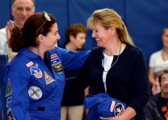 2014 HESA alumna Carolyn Scott (left) congratulates Molly McGarry on being selected to attend Honeywell Educators @ Space Academy in 2015.
