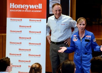 2015 HESA teacher Kathleen Boyce, Lincoln Middle School, describes Space Academy to her students as Honeywell Syracuse Program Director John McAuliffe listens.