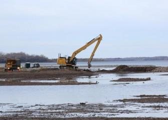 Topsoil placement occurs near the southwest corner of Onondaga Lake as capping operations wind down this year.