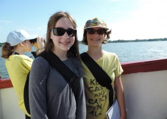 Emma Wilson (center) and Mary Roach (right), from East Syracuse Minoa Central School District, aboard the Emita II.