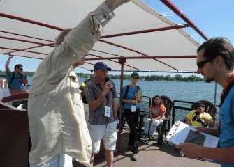 Syracuse University Professor of Environmental Systems Engineering and Distinguished Professor Charles Driscoll (center) speaks to students about the Onondaga Lake ecosystem and fish in the lake.