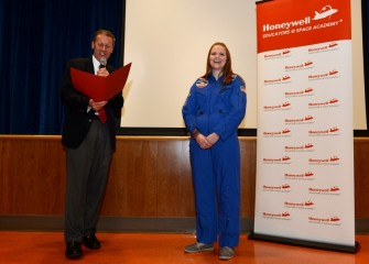 New York State Senator David J. Valesky surprises 2015 HESA teacher Sara Pieklik at Liverpool Middle School with a proclamation in recognition of her acceptance to Honeywell Educators @ Space Academy.