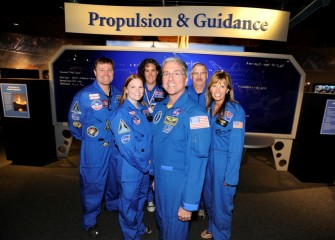 At the Milton J. Rubenstein Museum of Science & Technology (MOST) with former astronaut Donald Thomas (center) are Honeywell Educators (left to right) Robert Woolery, Sara Pieklik, Becky Loy, Brian Ramsden, and Kathy Conese. Thomas was in Syracuse for the 10th annual Honeywell Summer Science Week.