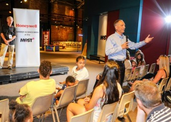 Honeywell's John McAuliffe addresses students and family members during the closing ceremony at the Museum of Science & Technology (MOST).
