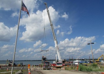 A booster pump is removed from a barge after hydraulic capping concludes.