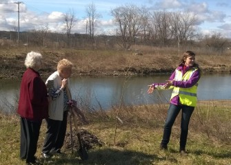 Natalia Cagide-Elmer (right), environmental engineer at Parsons, explains characteristics of the native American sycamore  tree making it well-suited for stream banks and wetlands.
