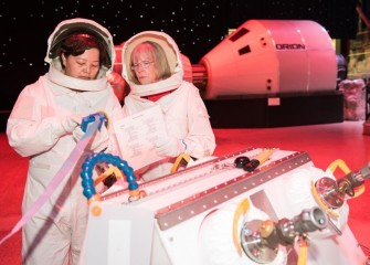 Colleen O'Connor (right) and a Team Kibo colleague during simulated astronaut training.