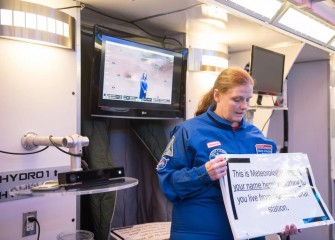Sally Mitchell, from Pine Grove Middle School, assists in broadcasting the weather from a lunar station during a HESA mission.