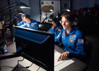 Team Columbus during a mission on Day 4 of Space Camp. Catherine Clift (right) was one of four Central New York teachers participating in the intensive five-day program this year.