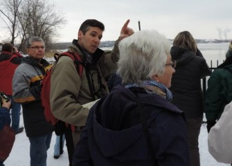 Montezuma Audubon Center Director Chris Lajewski (center left) also assists identifying birds. Several Bald Eagles are spotted along the Onondaga Lake shoreline.