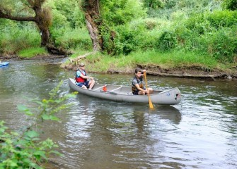 Scott (left) and Sam Stearns, from Marietta, navigate down a healthier Nine Mile Creek.