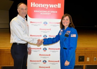 John McAuliffe, Honeywell Syracuse Program Director, congratulates teacher Katherine Clift at Camillus Middle School on receiving a scholarship to attend Honeywell Educators at Space Academy.