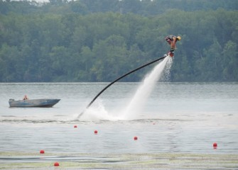 A flyboard demonstration takes place between corporate rowing heats.