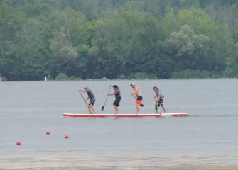 A dragon board, or four-person paddleboard, team practices before races.