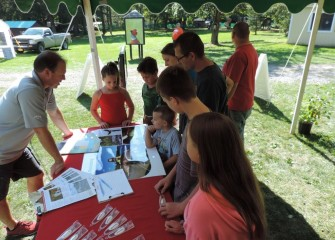 Visitors stopping at the Honeywell booth learn more about fish species returning to Onondaga Lake.