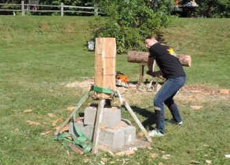 State University of New York College of Environmental Science and Forestry Woodsmen Team member Michelle Vasiloff demonstrates competition wood cutting.