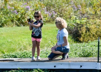 Nancy Lobello, member of the Iroquois Chapter of Trout Unlimited, teaches 7-year-old Saree Weed, of Moravia, to fly fish.