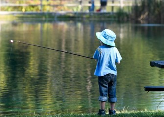 Four-year-old Zechariah Hartsell, of Fayetteville, fishes for trout.