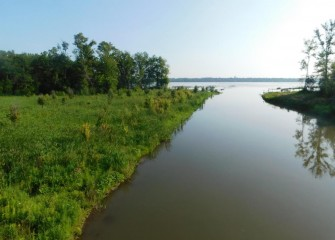 Restored wetlands at the mouth of Nine Mile Creek (left) were designed to adapt to varying water level conditions through the year as waters flood over banks and recede.