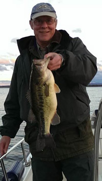 Ringler is an avid fisherman in his free time and is pictured above holding a largemouth bass caught in Onondaga Lake. He has studied the Onondaga Lake fishery for more than 30 years and is Vice Provost at the State University of New York College of Environmental Science and Forestry (SUNY-ESF).