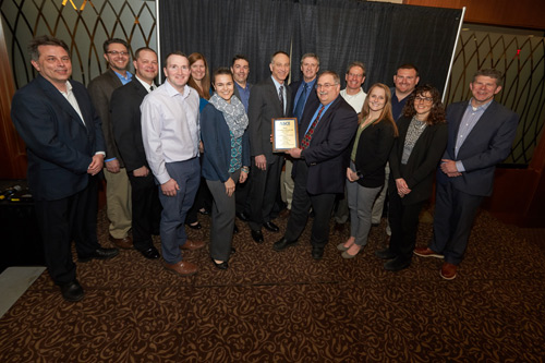 Onondaga Lake cleanup team representatives accept the 2018 Outstanding Civil Engineering Achievement Award from the Syracuse section of the American Society of Civil Engineers.