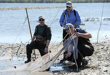 """""""Today's event provided me the opportunity to look at the health of Onondaga Lake and the surrounding land,"""" said Stephanie Cross, of Manlius, New York, pictured above (center). """"I'm thrilled to be here to see the progress and the types of fish species that are now being found in Onondaga Lake."""""""