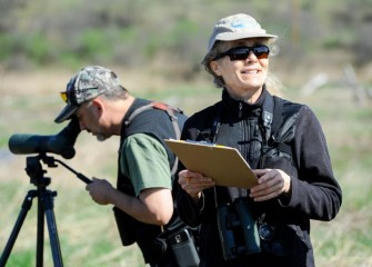 Ruth Florey (right), Onondaga Audubon Society member and Corps volunteer, tracks bird species with local wildlife photographer and Corps member Phillip Bonn.