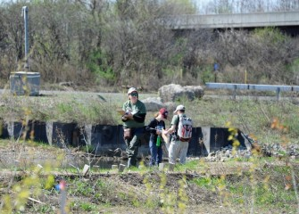 Volunteers with the Onondaga Lake Conservation Corps and the Young Naturalists Leadership Team (YNLT) of Izaak Walton League fan out to inventory plant and animal species.