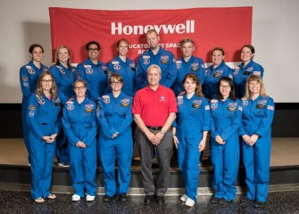 "Syracuse City School District teacher Erin Emanuele (top left) with her mission team at HESA, ""Team Zvezda,"" and astronaut speaker Lawrence (Larry) DeLucas, Ph.D. (center).  DeLucas was born in Syracuse, NY."