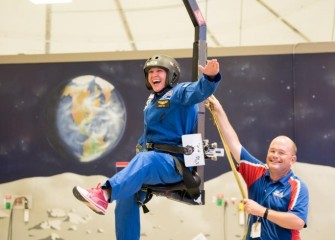 Michelle Hall in the 1/6th gravity chair at the U.S. Space & Rocket Center.