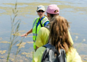 Jessica Saville, a habitat expert with Parsons, describes the new lake bottom created as part of the Onondaga Lake cleanup.