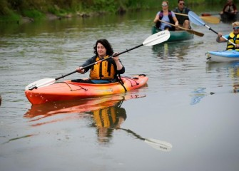 Lauren D'Hollander, of Washington, D.C. , enjoys the leisurely paddle along the creek.