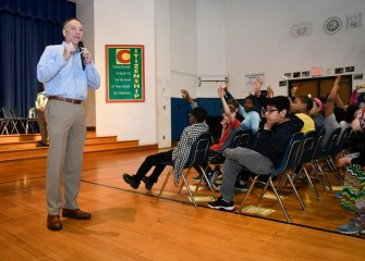 Honeywell Syracuse Program Director John McAuliffe speaks at J.T. Roberts PreK-8 School in the Syracuse City School District at a HESA recognition ceremony.