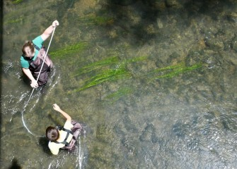 Students measure depth and stream velocity in Onondaga Creek.