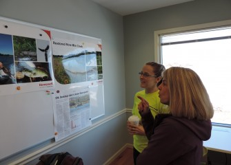 Barbara Johnson (right), of DeWitt, New York, learns about improvements at Onondaga Lake and nearby tributaries that are providing restored habitat for wildlife from Anne Burnham, a habitat expert from Parsons.