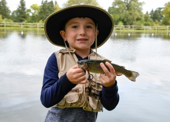 Six-year-old Grayson LaGrow, of Skaneateles, holds a trout caught in the public fishing pond at Carpenter's Brook Fish Hatchery.