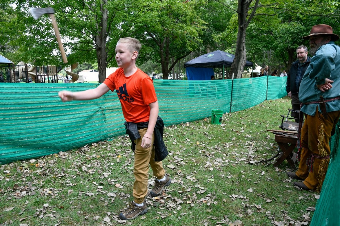 Ethan Jackson, age 12, of Elbridge, tries hatchet throwing at Honeywell Sportsmen's Days.