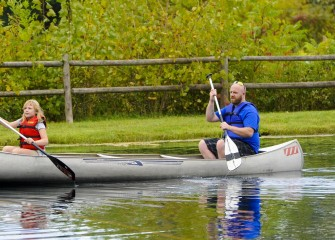 Cody Mehlenbacher (right), of Auburn, enjoys paddling across the pond at Carpenter's Brook Fish Hatchery with his daughter Gabriella.
