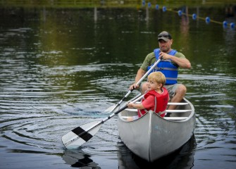 Dexter Rinaldi tries paddling backwards and with his dad, Damian. The father and son from Warners attended Honeywell Sportsmen's Days for the first time this year.
