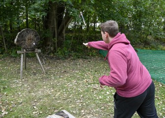 Luke Foster Springett, of Clay, throws a hatchet toward the wooden target.