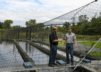 John McAuliffe (right), from Honeywell, is given a tour of the trout ponds at Carpenter's Brook Fish Hatchery by Onondaga County Parks Commissioner Bill Lansley.