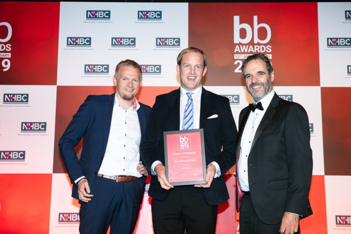 "Lord Matthew Taylor of Goss Moor (right) presents Honeywell's Nicholas Tymko (center) with a ""highly commended"" certificate in the Best International Project category at the 2019 Brownfield Briefing Awards."