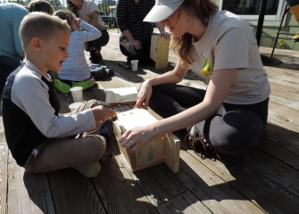 Haley O'Brien (right) helps six-year-old Holden Sunkes assemble a bird box. Nesting boxes were provided by the New York State Office of Parks, Recreation and Historic Preservation and FORCES (Friends of Recreation, Conservation and Environmental Stewardship).