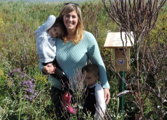 Bridget Sunkes, of East Syracuse, with children Eleanor and Holden, by the bird nesting box they helped build and place in restored habitat near Onondaga Lake.