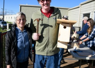Mary Giehl and Greg Boyer, of Syracuse, with an assembled bluebird nesting box. According to Audubon, the Eastern Bluebird, state bird of New York, has declined in many areas due in part to loss of nesting sites.