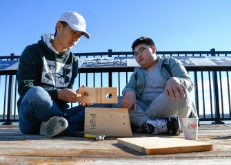 Jeffrey (left) and Peter Wang, of Manlius, assemble a bluebird nesting box on the deck at the Onondaga Lake Visitors Center.