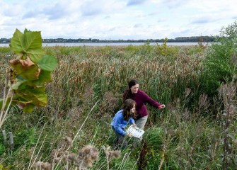 Janna Keefe and daughter Evie work on the scavenger hunt inventorying plant species.