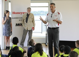 Honeywell Syracuse Program Manager Stephen Miller welcomes students to the Honeywell Onondaga Lake Visitors Center as they look forward to a week of hands-on science exploration in the Onondaga Lake watershed.