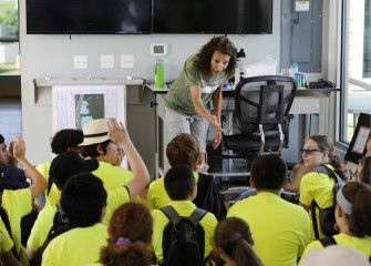 Onondaga Lake Conservation Corps educator Sue Potrikus engages students in a discussion after viewing a video about the Onondaga Lake cleanup.