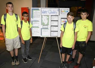 Students (left to right) Xavier Greene, Ahmed Fakhr, Nate Porter, and Lucas Aldinger analyzed data and created a poster on water quality for Discovery Day.